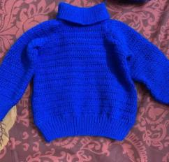 Hand made woolen baby clothes