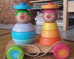 Wooden stack and pull along toy