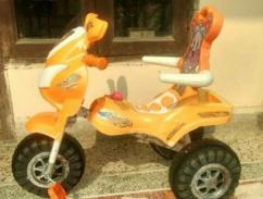 Tricycle In Orange Color
