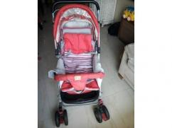 Branded pink Coloured pram