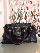 Black In Color Handbag In Recent Design