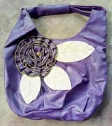 Purple in color Handbag Available