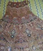 Very heavy and beautiful A-line maroon colour bridal lehanga.