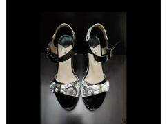 Black and white heels with golden work and flowers pattern