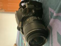 Nikon D3100 for sale with basic lens and carry bag