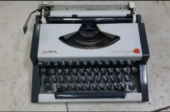 Olampia Typewriter with box and new ribbon working