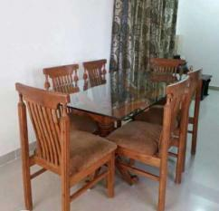 Dinning table with glass top with six chairs in solid teak wood