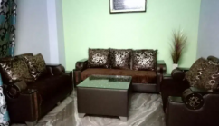 7 seater well furnished sofa set with one center table and puffed cushions