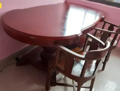 Wooden Dining table of oval shape with two chairs