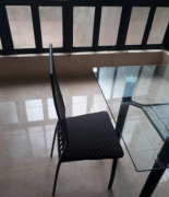Glass top Dining Table with 4 powder coated chairs for sale