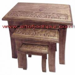 Carved wooden nesting tables