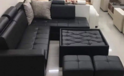 Brand new 8 seater sofa set with table in black colour.