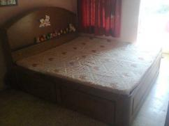 Wooden double bed with storage and Wooden sofa with cushions