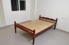 Wooden cot in low rate...