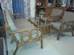 5 seater cane sofa in good condition with centre table having glass top