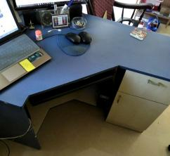 L-shaped computer table. 1 drawer and 1 cabinet