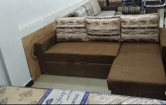 Brown Sofa Cumbed With Printed Cushions