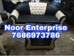 Black an cream C model 3 seater exclusive sofa.