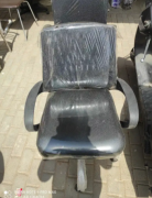 Mesh back chair with height adjustable and push back.