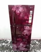 LG double door pink in color flower design refrigerator