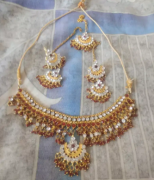 Adjustable Necklace in red golden and white Colour