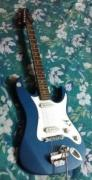 White And Blue Coloured Guitar Available
