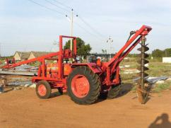 Auger machine tractor attached for contractor using purpose